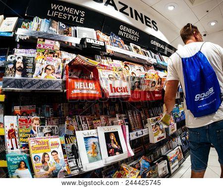 London, United Kingdom - May 20, 2018: Man Shopping For Fresh Press In London Press Kiosk