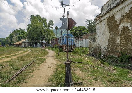 Oaxaca, Oaxaca, Mexico- June 1, 2018: Landscape With Tracks And An Old Blue Train In A Sunny Day At