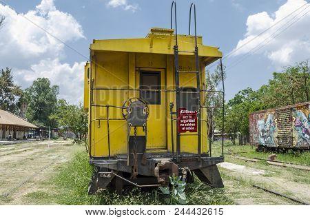 Oaxaca, Oaxaca, Mexico- June 1, 2018: Old Rusty Railway Yellow Carriage In A Sunny Day At Ferrocarri