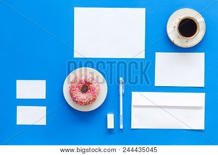 Come Up With Brand Identity. Blank Stationery For Branding Near Coffee And Donut On Blue Background