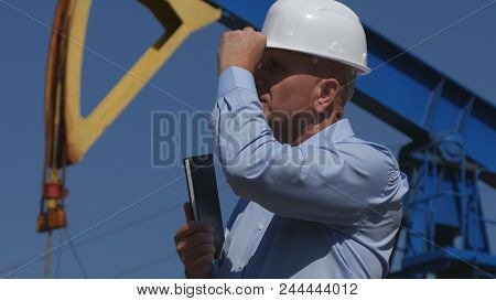 Confident Petroleum Engineer Working In Extracting Oil Industry Checking Installation