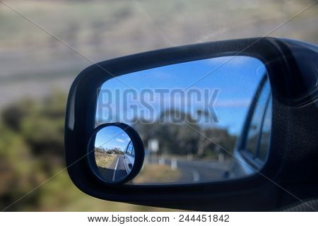 Rear View Mirror, Side Mirror, Rear Vision Mirror With Town Road In Background,