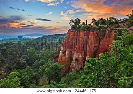 Roussillon, Provence, France: Landscape At Dawn Of The Reds Ochre Rocks And The Green Valley In The
