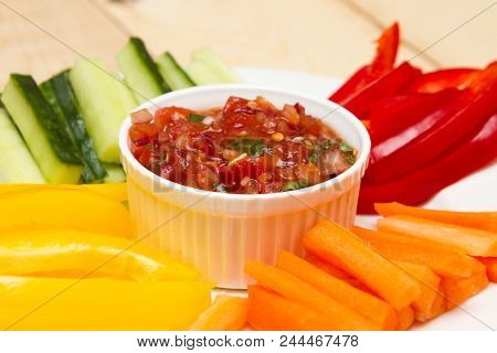 Salsa Dip A Starter Of Salsa And Different Dips Carrot, Pepper And Cucumber