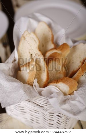 Close-up With Elegant White Basket With Fresh Bread.