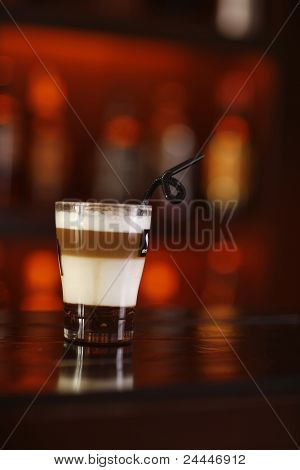 Triple Layered Coffee Drink In A Shot Glass.
