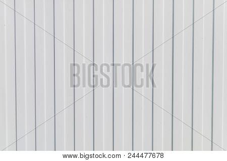 White Background With Horizontal Stripes. White Metal Fence With Horizontal Stripes. Horizontal Stri