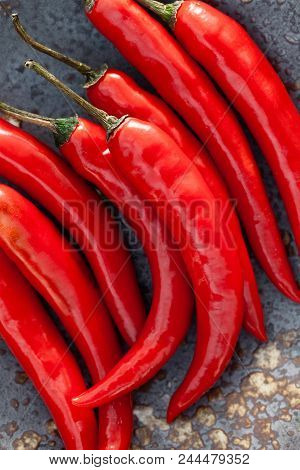 Red Chilli Pepper In Vintage Dish Closeup.