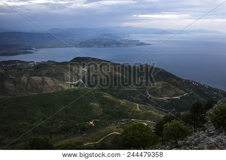 Small Hills With Lot Of White Roads Acting Like Silver Necklace For Them. In The Hills We Can See So