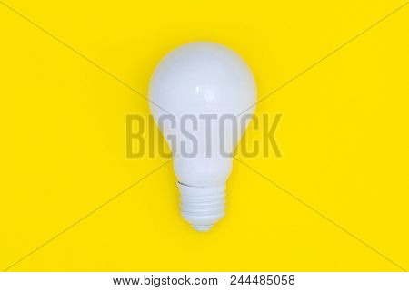 White Light Bulb Isolated On Yellow Background, Top View, Minimal Concept, Creative Idea And Innovat