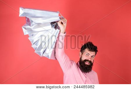Guy Shopping On Sales Season With Discounts. Man With Beard And Mustache Holds Shopping Bags, Red Ba