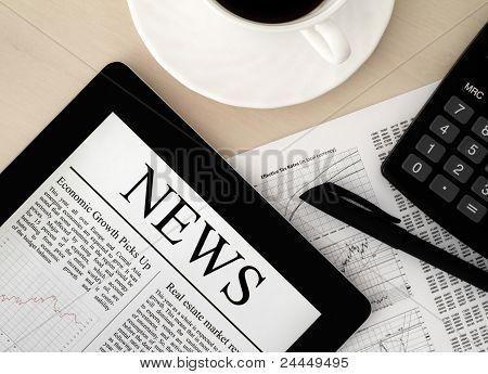 Apple Ipad With News On Desk