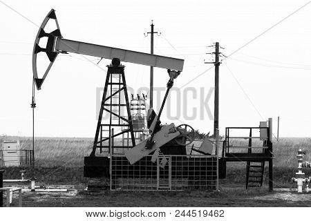 Oil Pumps. Oil Rocking Chair. Oil Industry Equipment. Oil Rocking Chair Closeup.