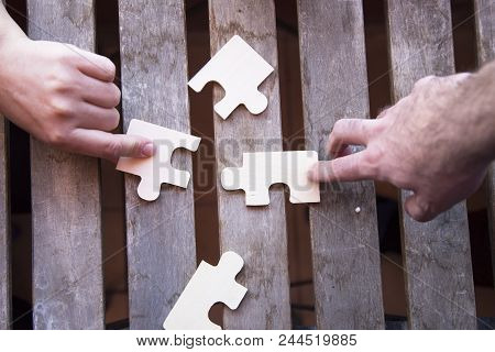 Business Partnership Or Teamwork Concept With A Business People Presenting A Matching Puzzle Piece A