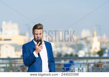 Businessman Serious Face Received Important Message, Skyline Background. Message Concept. Man In Sui