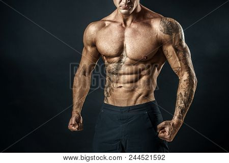 Unrecognizable Strong Bodybuilder With Six Pack. Bodybuilder Man With Perfect Abs, Shoulders, Biceps