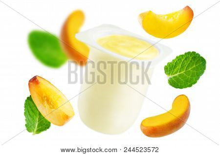 Flying Peach Yogurt With Flying Peaches And Mint Isolated