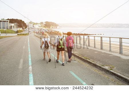 Brest , France 28 May 2018 Three Happy Women Hiking Together On The Road Near The Ocean On An Advent