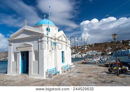 Mykonos, Greece - May 04, 2010: Church Building On Sea Quay With Nice Architecture. Agios Nikolaos C