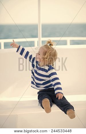 Child Is Resting On The Boat. Childhood And Baby Care Concept. Yachting And Sailing. Small Adorable