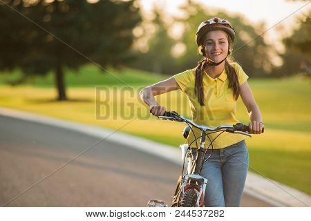 Portrait Of Joyful Girl With Bicycle Outdoors. Happy Teenage Girl Posing With Bicycle On Country Roa