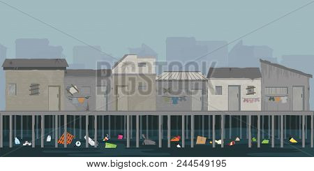 Landscape Of Wooden House On The Riverbank With Garbage, Slum Area Over The River, Poverty And Socia