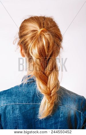 Head Of A Young Woman Look From Behind. Rear View Braid Hairdress. Rear View Portrait Of Attractive
