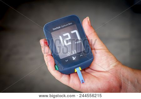 Woman Patient With Pregnancy Diabetes Holding In Her Hands A Freestyle Optium Neo Glucometer After T