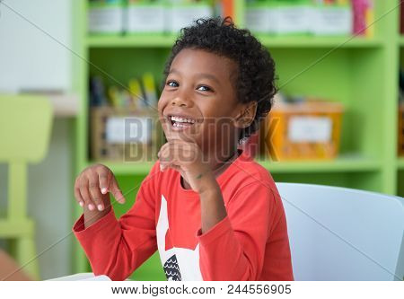 African American Ethnicity Kid Smiling At Library In Kindergarten Preschool Classroom.happy Emotion.