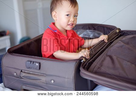 Cute Little Asian 18 Months / 1 Year Old Toddler Baby Boy Child Sitting In Travel Suitcase Getting R