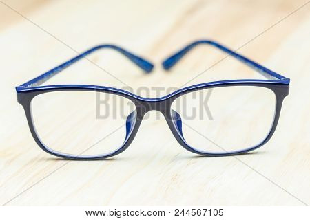 Modern Eye Glasses On Wood Background. Blue Glasses. Glasses On Wood Table. Glasses For Design. Glas