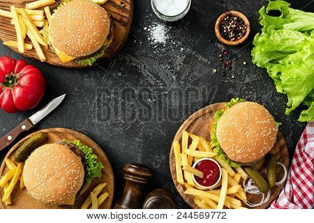 Burgers, Hamburgers, French Fries And Fresh Vegetables. Bbq Party Food. Dark Background, Top View An