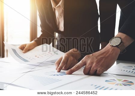 Business People Using Pen,tablet,notebook Are Planning A Marketing Plan To Improve The Quality Of Th