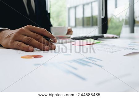 Data Analyzing. Close Up Of Business Man Adviser Using Pen Pointing Document Report And Discussing W
