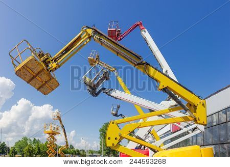 Fragment Of The Booms With Baskets And Top Parts Of Different Articulated Boom Lifts And Scissor Lif