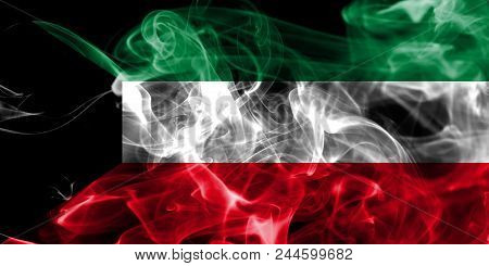 Kuwait Smoke Flag On A Black Background