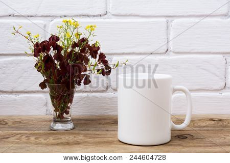 White Coffee Mug Mockup With Maroon And Yellow Grass