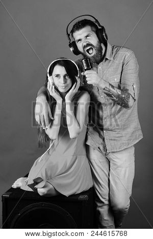 Couple Listening To Music. Party And Music Concept. Man With Beard And Girl Sit On Black Boombox On