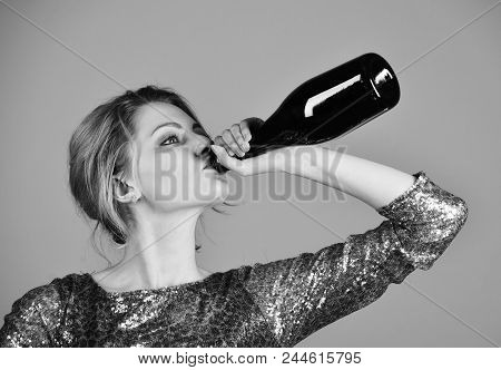 Female Alcoholism. Woman With Serious Face Drinks Expensive Cabernet Or Merlot From Bottle. Alco Par