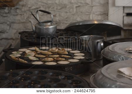 Cooking Of Thai Sweet Coconut Rice Hotcakes On The Stove