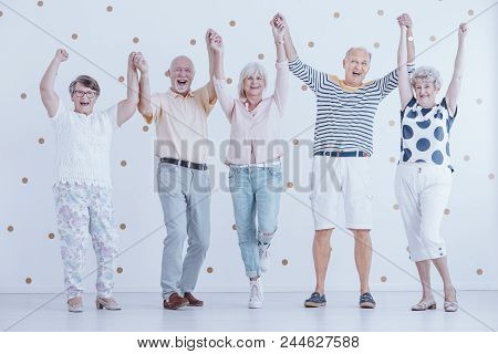Smiling Elderly People Having Fun While Enjoying New Year's Eve Party