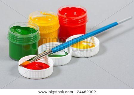 Set of art gouache paints and brush