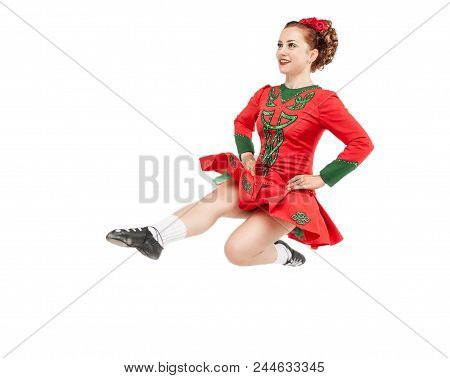 Beautiful Woman In Dress For Irish Dance Jumping Isolated