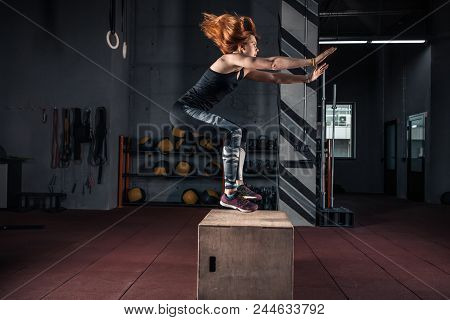 Side View Image Of Fit Young Woman Doing A Box Jump Exercise. Muscular Woman Doing A Box Squat At Th