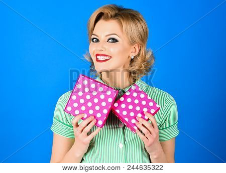 Happy Woman In Pin-up Style Dress Holding Gift Box. Beautiful Blonde Pin-up Girl Holds Gifts Boxes.