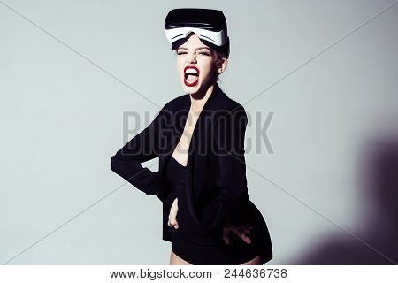 Expressive Emotional Woman Wears Virtual Reality Goggles. Excited Attractive Girl Using 3d Goggles W