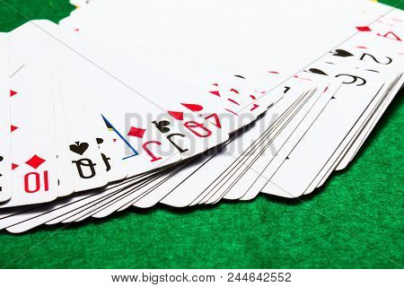 Fan Deck Deck Of Playing Cards On A Bright Green Canvas Concept Of Board Games And Casinos