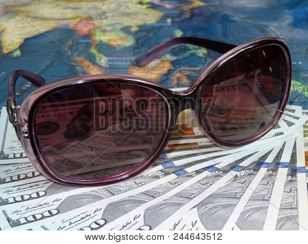 Sun Glasses And Us Dollars On Background Of Asia Map. Tourism And Beach Holidays In South-east Asia,