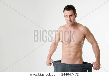Diet And Sports. Young Athletic Guy In Big Pants. Losing Weight. Guy, Sports And Fitness, Healthy Li