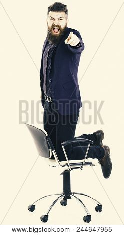 Angry Boss Concept. Company Leader Stands On Chair With Angry Face.